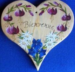 Fleurs de montagne sur coeur